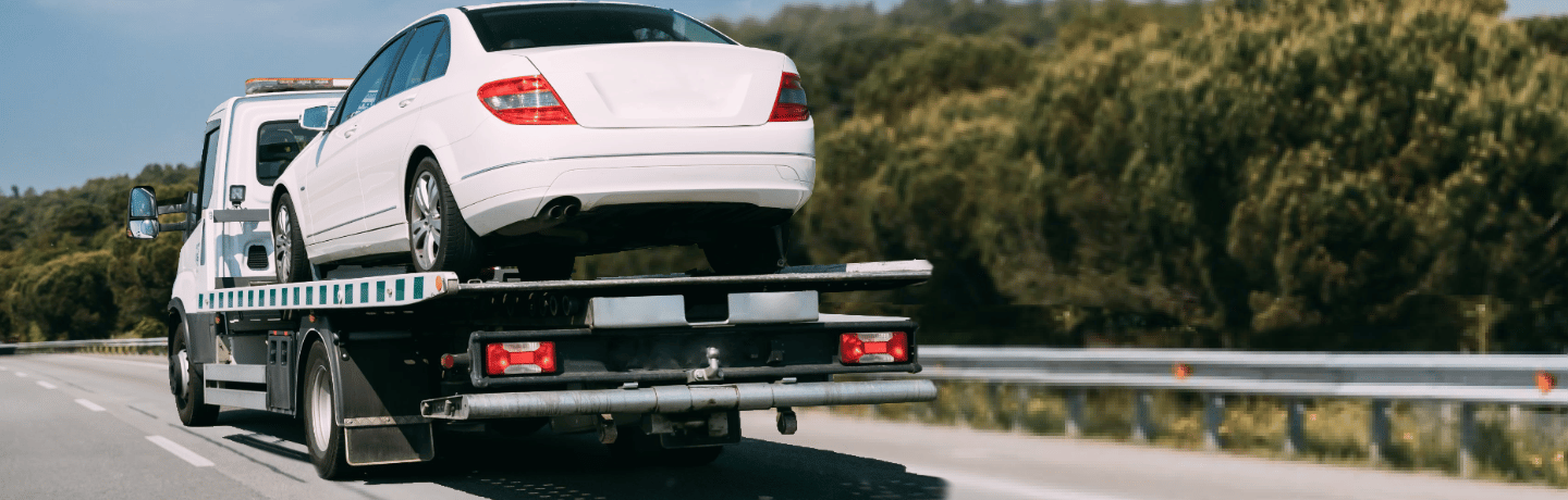 Car Shipped on Flat Bed Truck