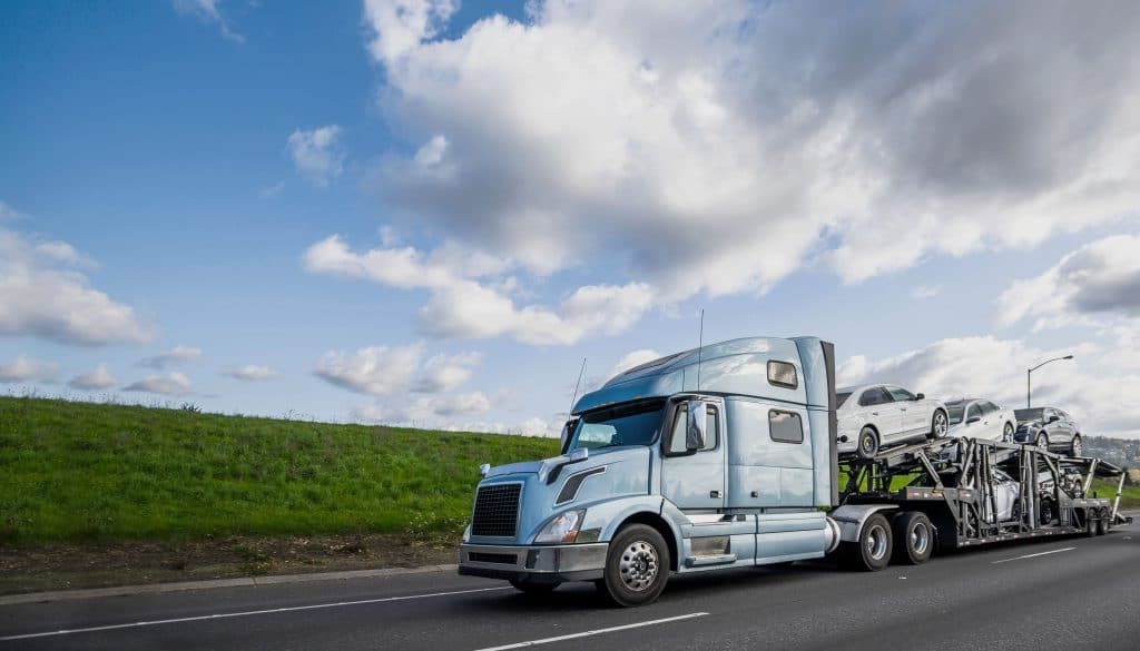 Semi truck hauls automobiles across the country.